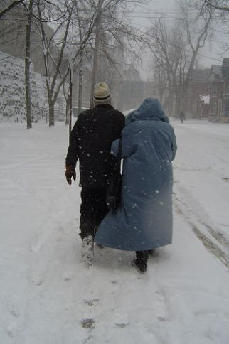 Old couple walking in the snow.