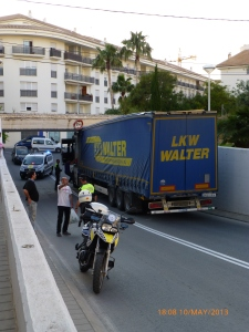 Lorry caught under a bridge