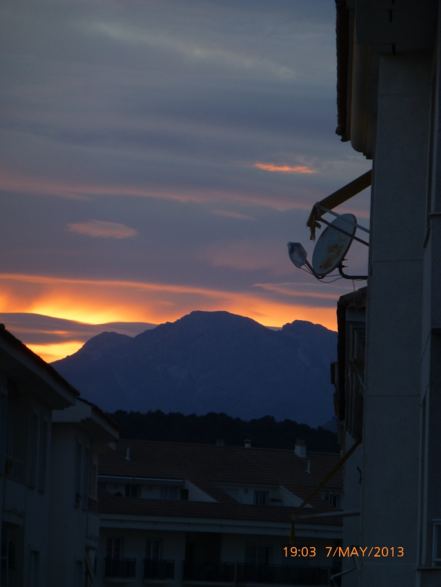 Altea is surrounded by mountains and it is behind these that the sun sets.