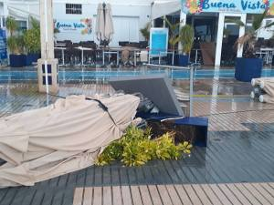 Overturned patio furniture and pots